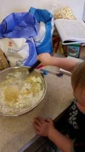He REALLY wanted to do it himself... but this time I didn't turn away until the flour was combined. :)
