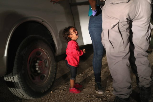 A 2-year-old seeks asylum with her mother at the border.